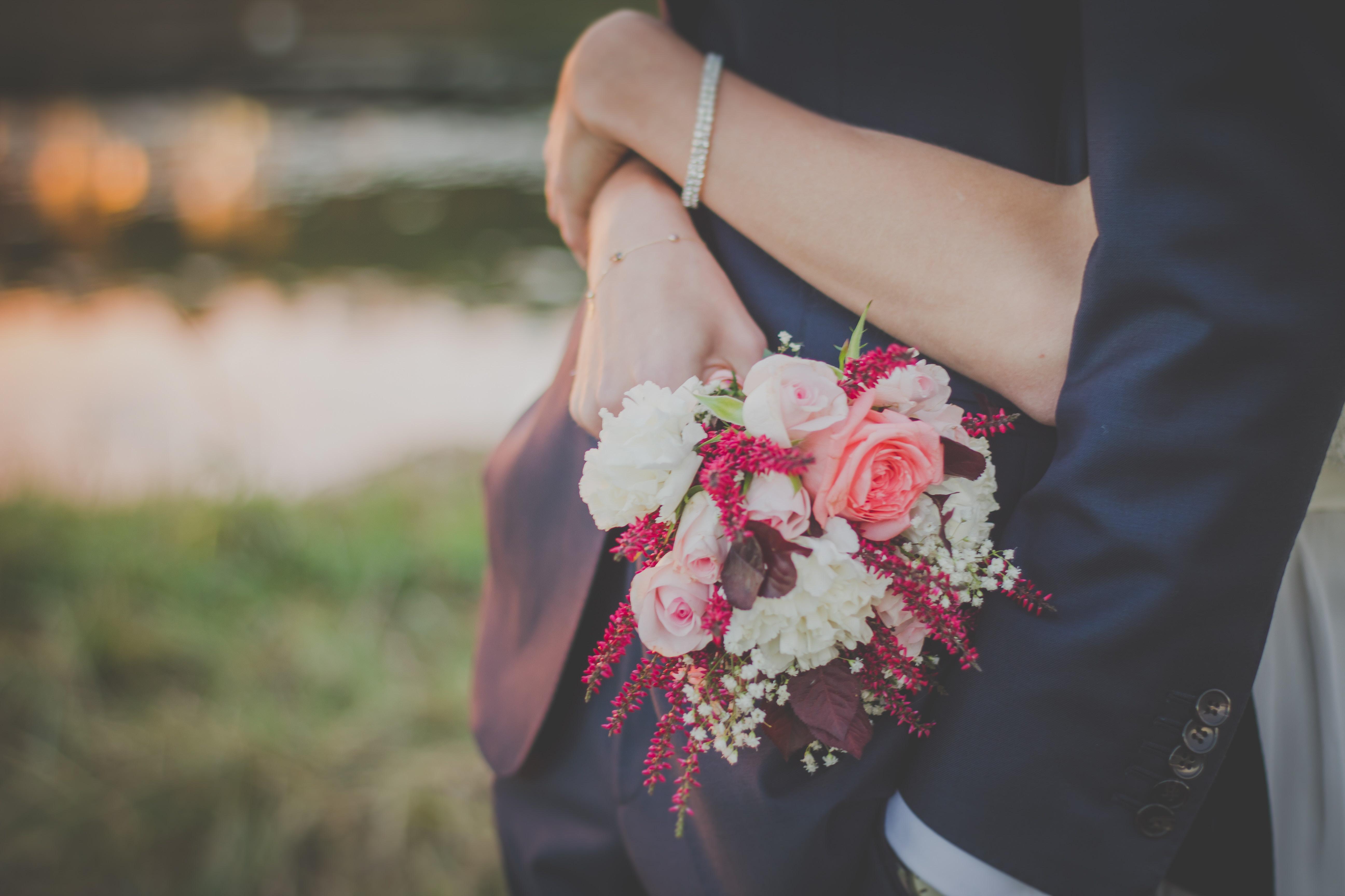 embracing newlywed couple